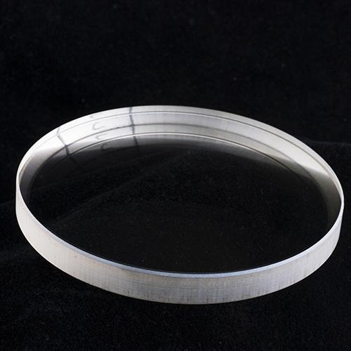 Nonplanar optical lens